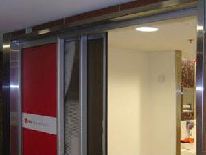 Maximum door opening using flush line glazing